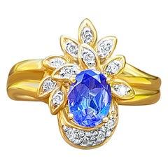 Oval-Cut Tanzanite, Diamond and 14 Karat Yellow Gold Cocktail Ring