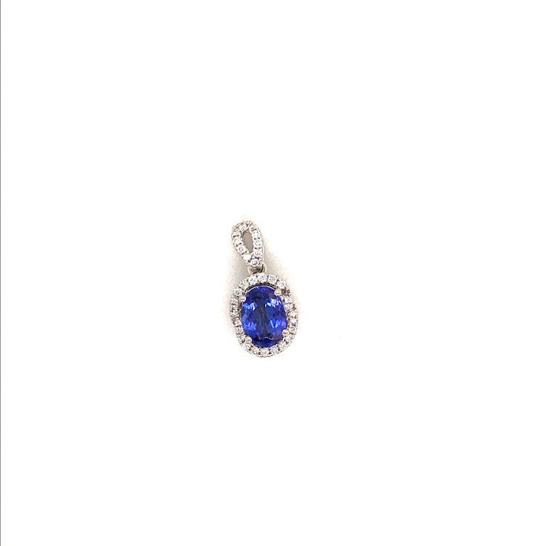 Contemporary Oval Cut Tanzanite with Diamond Halo Pendant 1.55 Carat 14 Karat White Gold For Sale