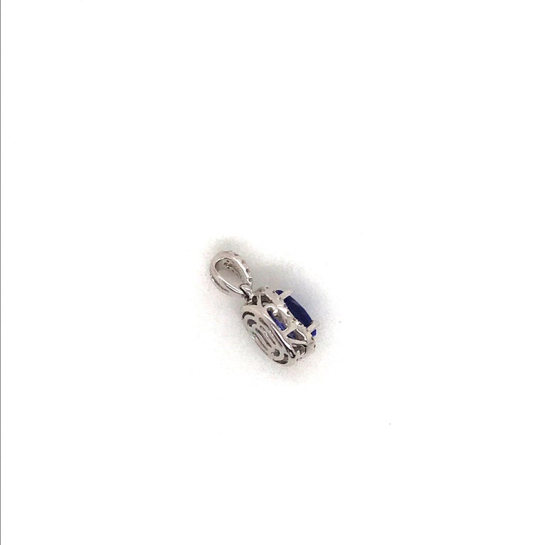 Oval Cut Tanzanite with Diamond Halo Pendant 1.55 Carat 14 Karat White Gold In New Condition For Sale In New York, NY