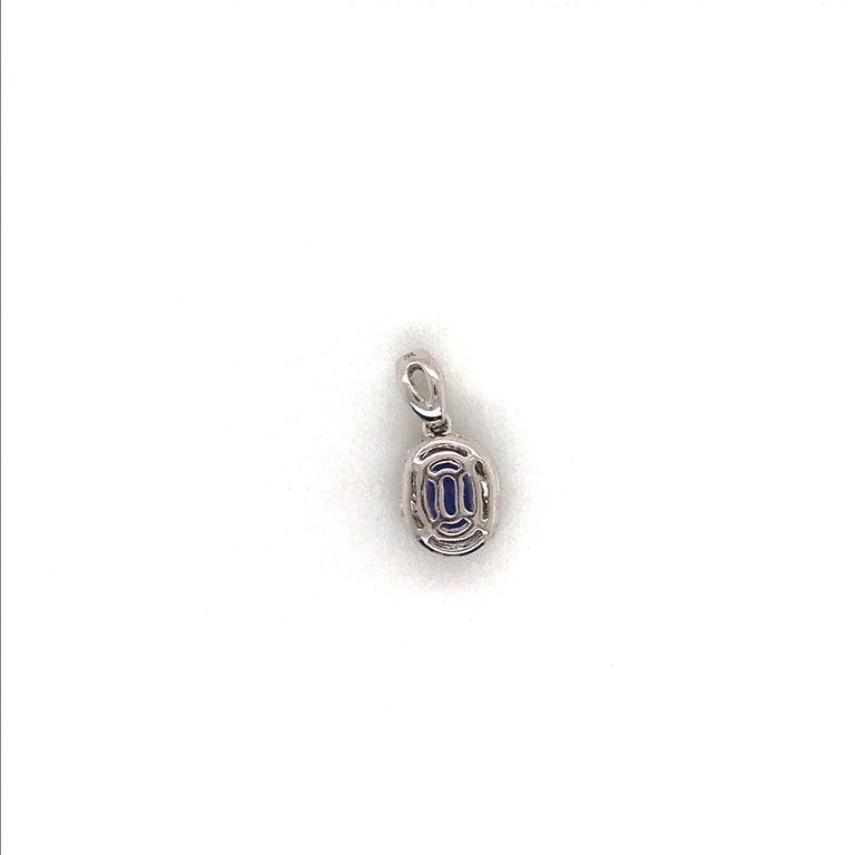 Women's Oval Cut Tanzanite with Diamond Halo Pendant 1.55 Carat 14 Karat White Gold For Sale