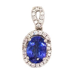 Oval Cut Tanzanite with Diamond Halo Pendant 1.55 Carat 14 Karat White Gold