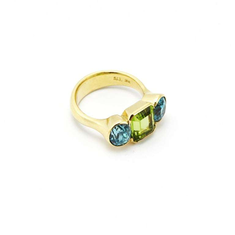 Wow! The brilliance of color in this Oval Cut Zircon (5.8ct) and Emerald Cut Peridot (4.07ct) ring is truly an eye catcher.  Dimensions of Peridot: 7.94mm x 10.3mm Dimensions of Zircon: 6.2mm x 7.33mm *Dimensions of Band: 4.52mm x 1.95mm *Can be