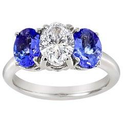 Oval Diamond and Tanzanite Three-Stone Ring in 14 Karat White Gold