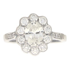 Oval Diamond Cluster Halo Engagement Ring Set in Platinum