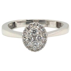 Oval Diamond Cocktail Ring with 14 Karat Gold
