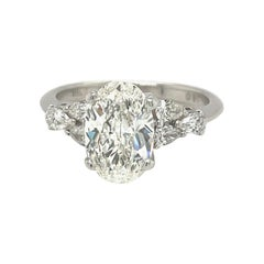 Oval Diamond GIA Certified 1.71 Ct. H VS1 Plat Setting with 0.35ct Pear Diamonds