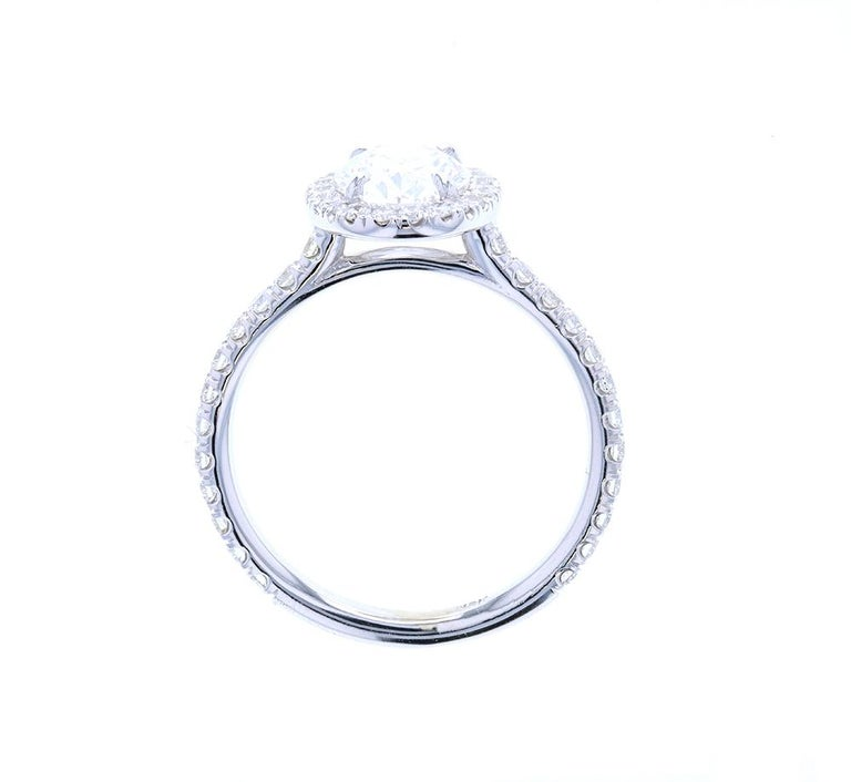 This gorgeous diamond engagement ring features a oval center with a diamond halo and a built-in setting. This style of engagement ring is our most popular and is perfect for any shape center stone.  This style of engagement ring can be made in any