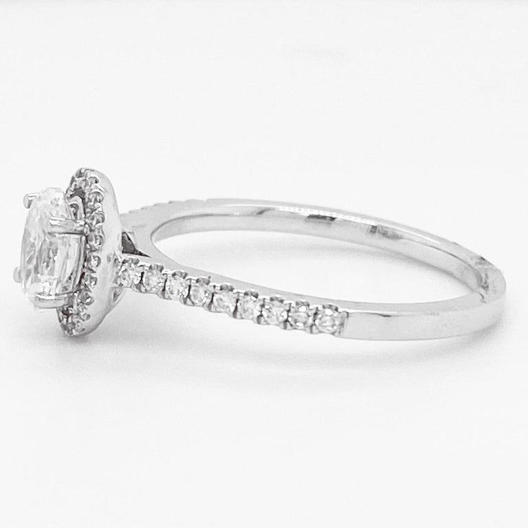 Modern Oval Diamond Ring, White Gold, .72 Carat Diamond Oval Halo Engagement Ring For Sale