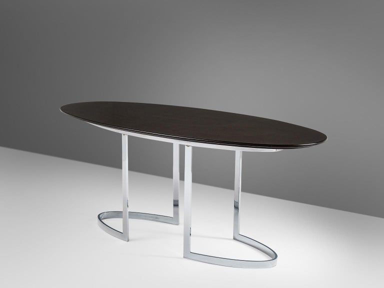 Dining table by Cidue, in metal and wood, Italy, 1970s.   Oval shaped dining table. This table with dark brown top has an elegant and modern design. The base in chromed metal strips is a beautiful repetition and yet also a variation on the oval