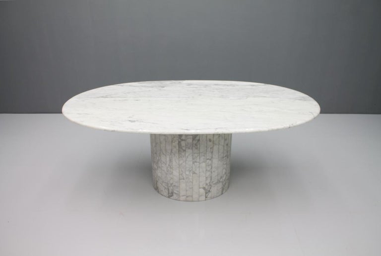 Very nice large oval dining table in white grey Carrara marble. The tabletop has been resealed and polished with epoxy resin. The table has no damage and no repairs. 