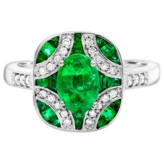 Oval Emerald 0.80 Carat with Baguettes and Diamonds 14 Karat Gold Cocktail Ring