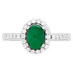 Oval Emerald 14 Karat White Gold Diamond Halo Ring