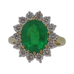 Oval Emerald and Diamond Claw Set Cluster Ring 18 Karat Yellow and White Gold