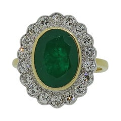 Oval Emerald and Diamond Cluster Ring 18 Karat Yellow and White Gold