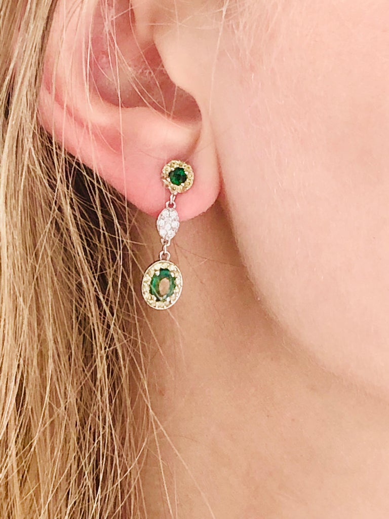 Contemporary Oval Emerald and Diamond Drop Earrings One Inch Long For Sale