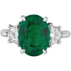 Oval Emerald Engagement Ring with Diamond Side Stones Platinum Andreoli