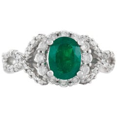 Oval Emerald on 18 Karat White Gold Setting with Diamonds Ring