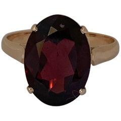 Oval Garnet Set in 14 Karat Yellow Gold Ring