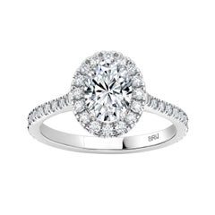 Oval GIA Certified 0.70 Carat Halo Diamond Engagement Ring