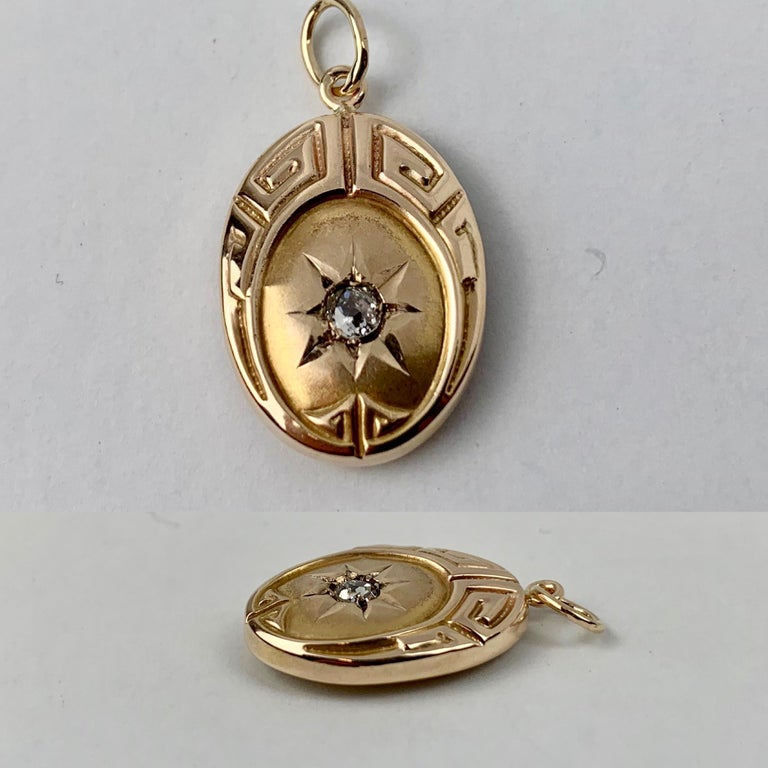 Perfect little oval 10k yellow gold pendant with a Greek key motif and a diamond centered in a sunburst. Professionally cleaned and polished. 1.2 grams