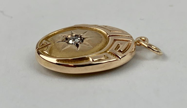 Late Victorian  Greek Key Motif Oval Pendant with Diamond- 10 Karat Yellow Gold