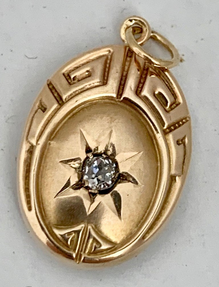 Greek Key Motif Oval Pendant with Diamond- 10 Karat Yellow Gold  In Good Condition In West Palm Beach, FL