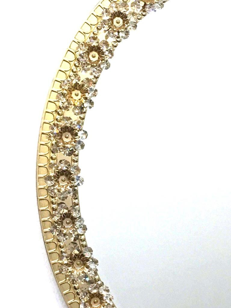 Hollywood Regency Oval Gold Plated Brass and Crystal Flowers Mirror by Palwa, circa 1960s For Sale