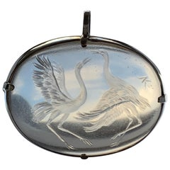 Oval Intaglio Pendant of Fighting Cranes Set in Silver