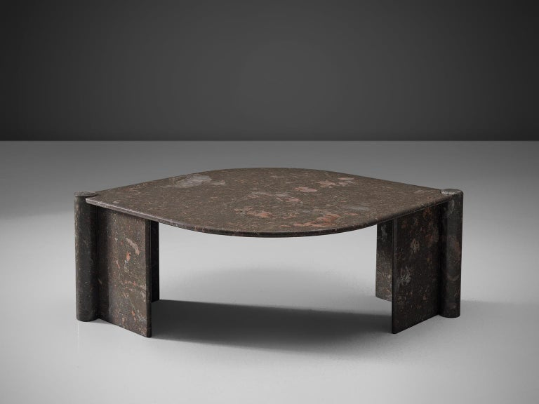 Side table, marble, Italy, 1970s.  This sculptural table has an eye-shaped top and two open triangles that face one another. The circular ends of the base locks the top by means of gravity. The construction is so smoothly designed that everything