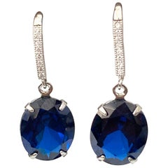 Oval Lab Sapphire on micropave sterling silver hook earrings