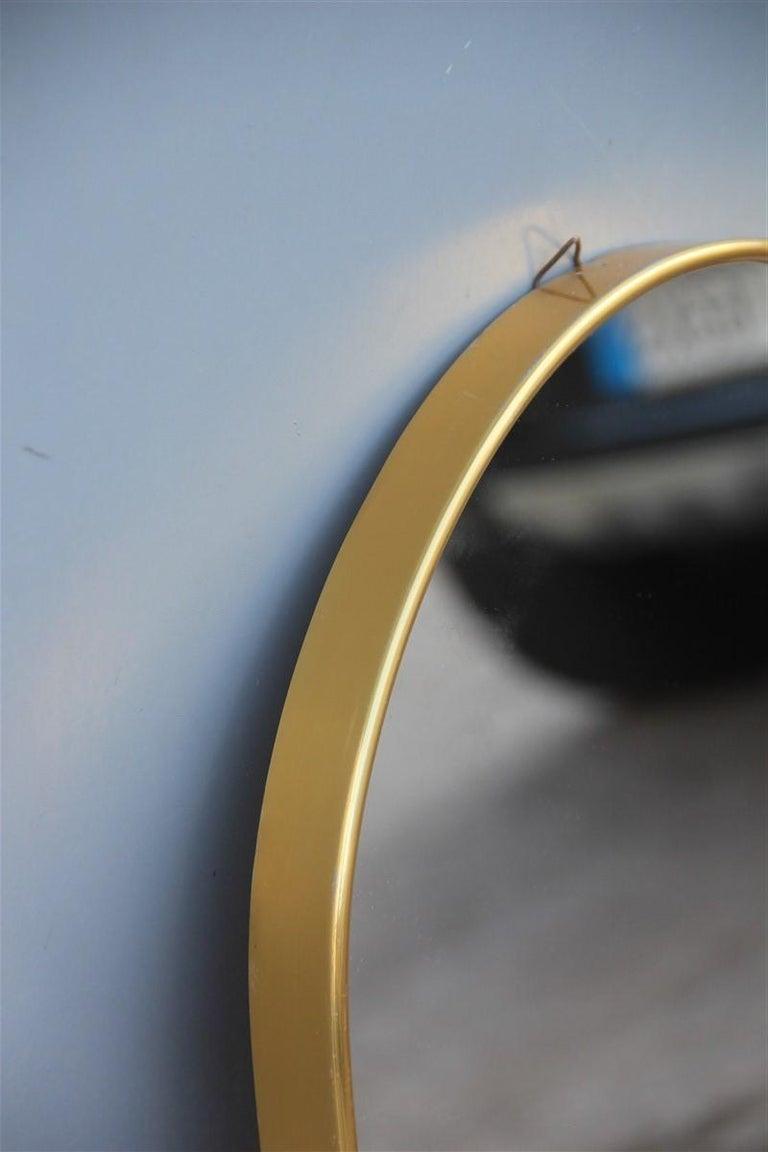 Oval midcentury Italian wall mirror aluminum golden 1950s Italian design.