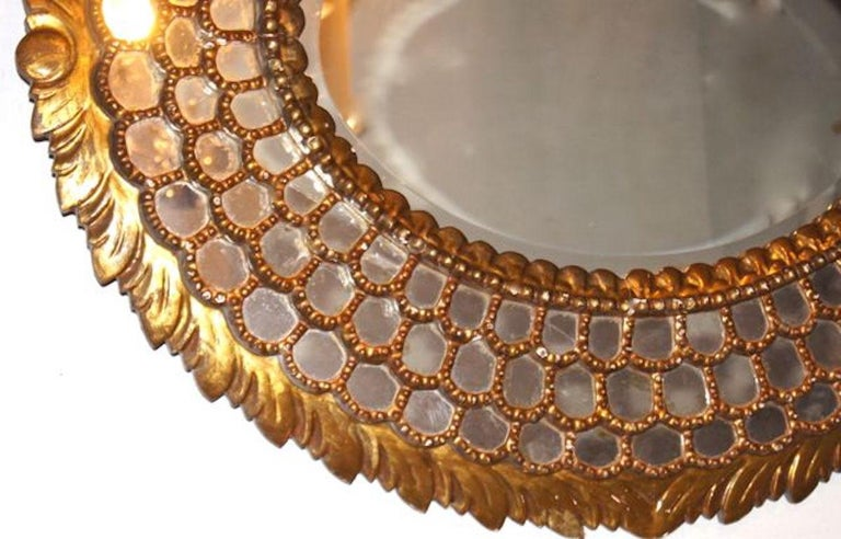 A circa 1920s Spanish large oval giltwood mirror with mirror mosaic frame with original patina.  Measurements: Height 39