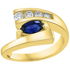 Oval Natural Blue Sapphire and Diamond Engagement Ring in 14 Karat Yellow Gold