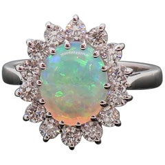 Oval Opal and Diamond Claw Set Cluster Ring 18 Karat White Gold