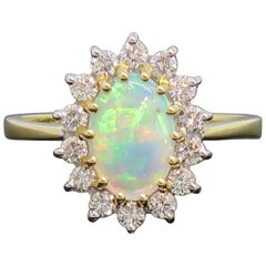 Oval Opal and Diamond Claw Set Cluster Ring 18 Karat Yellow and White Gold