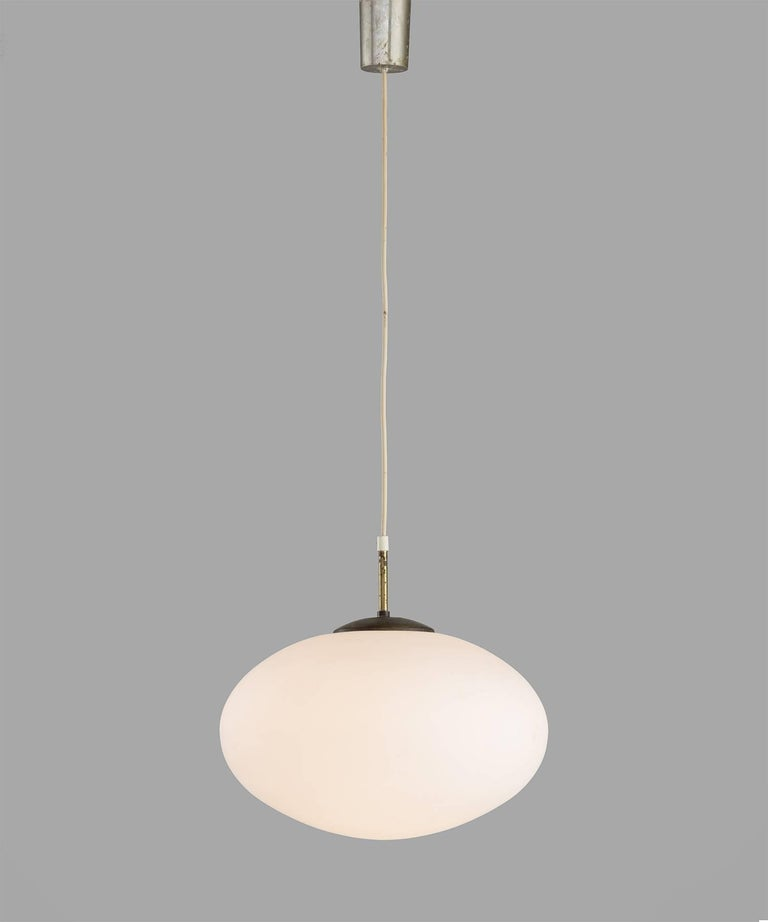 Oval opaline glass modern pendant, England, circa 1950.
