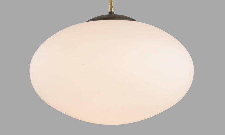 English Oval Opaline Glass Modern Pendant, England, circa 1950