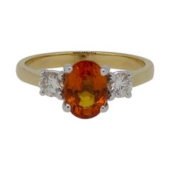Oval Orange Sapphire and Diamond Three-Stone Ring 18 Karat Yellow and White Gold