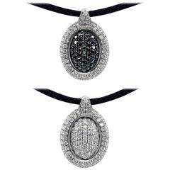 Oval Pendant with Reversible Black and White Diamond Center in 18 Karat Gold