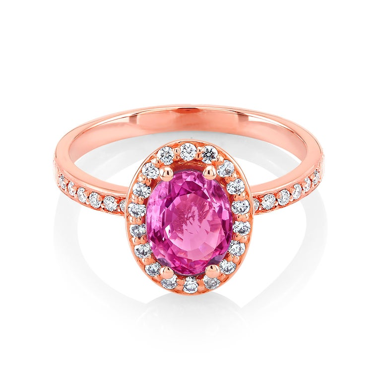 Eighteen karats rose gold cocktail ring  Ceylon oval shape pink sapphire weighing 1.10 carat   Diamonds weighing 0.65 carat Ring size 6 In Stock New Ring One of a kind ring  The ring can be resized  OGI diamonds have no enhancement OGI does not use