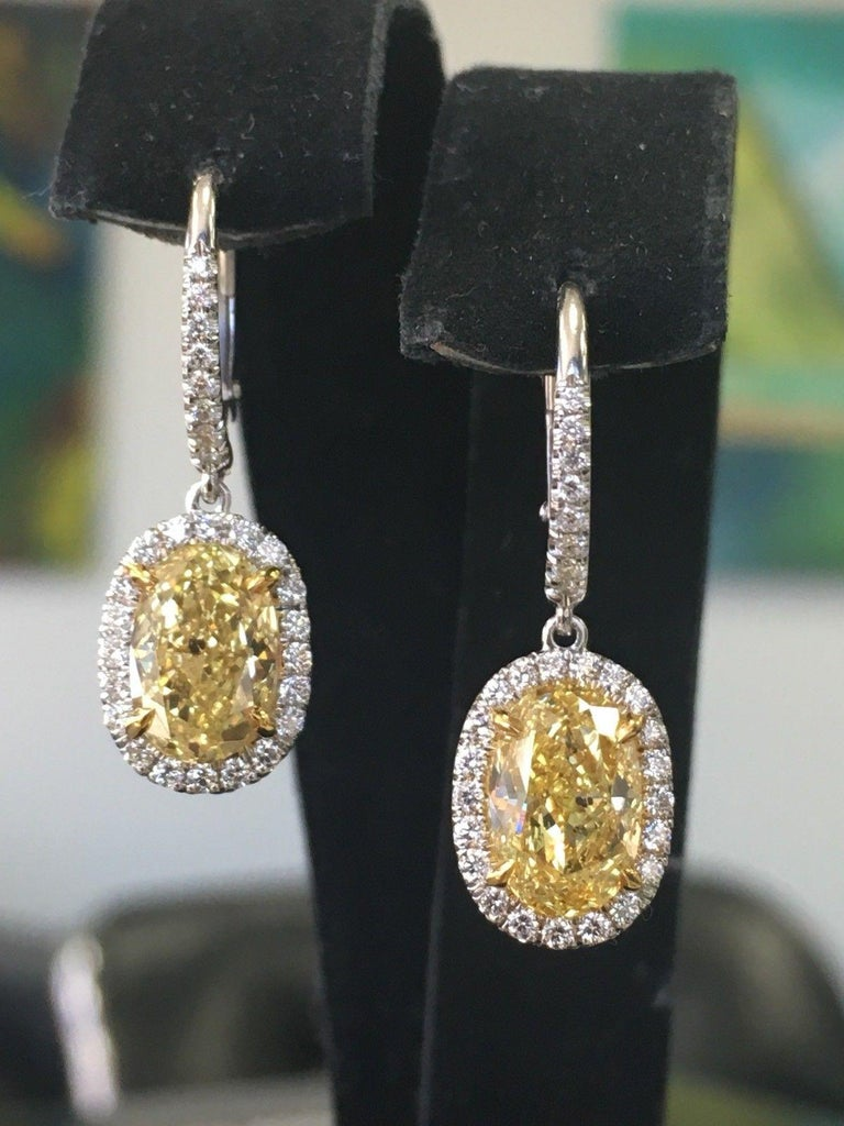 Modern Oval Platinum Earrings 3.51 Carat GIA Natural Fancy Intense Yellow and Colorless For Sale