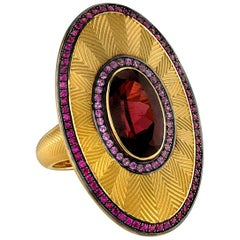 Oval Rhodolite Garnet with Pink Sapphires and Rubies, 18 Karat Yellow Gold Ring