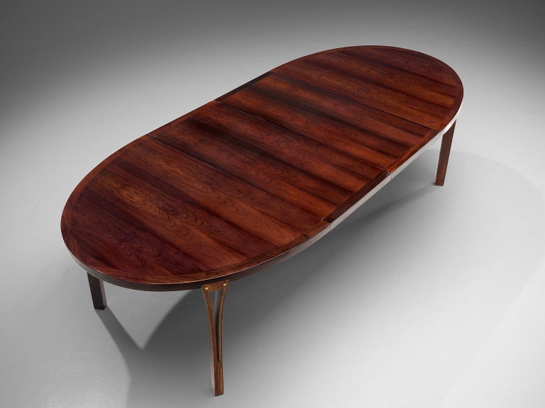 Mid-Century Modern Oval Rosewood Dining Table with Brass Details For Sale