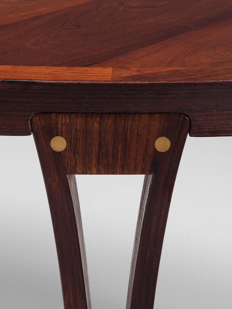 Oval Rosewood Dining Table with Brass Details For Sale 1