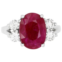 Oval Ruby and Diamond Side Stone Engagement Ring in 18K White Gold