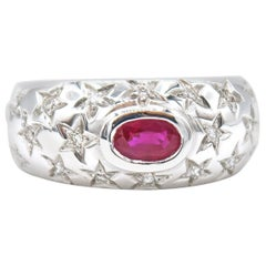 Oval Ruby and Star Engraved Diamond 18 Karat Gold Ring