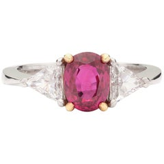 Oval Ruby, Diamond, Platinum and Yellow Gold Ring