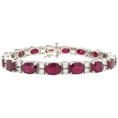 Oval Ruby Diamond Tennis Bracelet 23.82 Carat 14 Karat White Gold