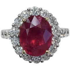Oval Ruby Fashion Ring with Multiple Round Diamonds