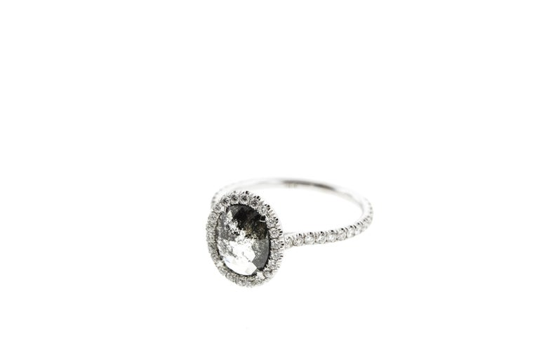 This oval salt and pepper diamond is surrounded by a halo of white diamonds and set in built-in white gold setting with an open basket. Salt and pepper diamond come in a variety of shapes: round and oval salt and pepper diamonds are extremely